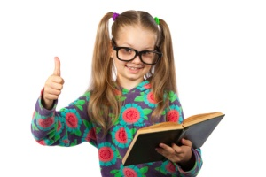 Girl with glasses reading a book on white background